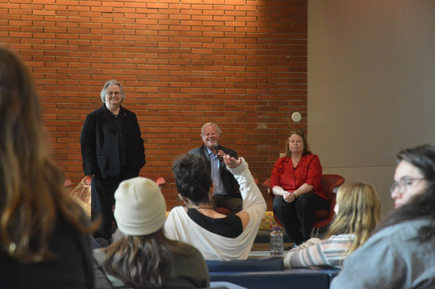 Pacific University President Lesley Hallick, left, held the institution's first open forum Nov. 7 to allow students' voices to be heard on a variety of university topics.