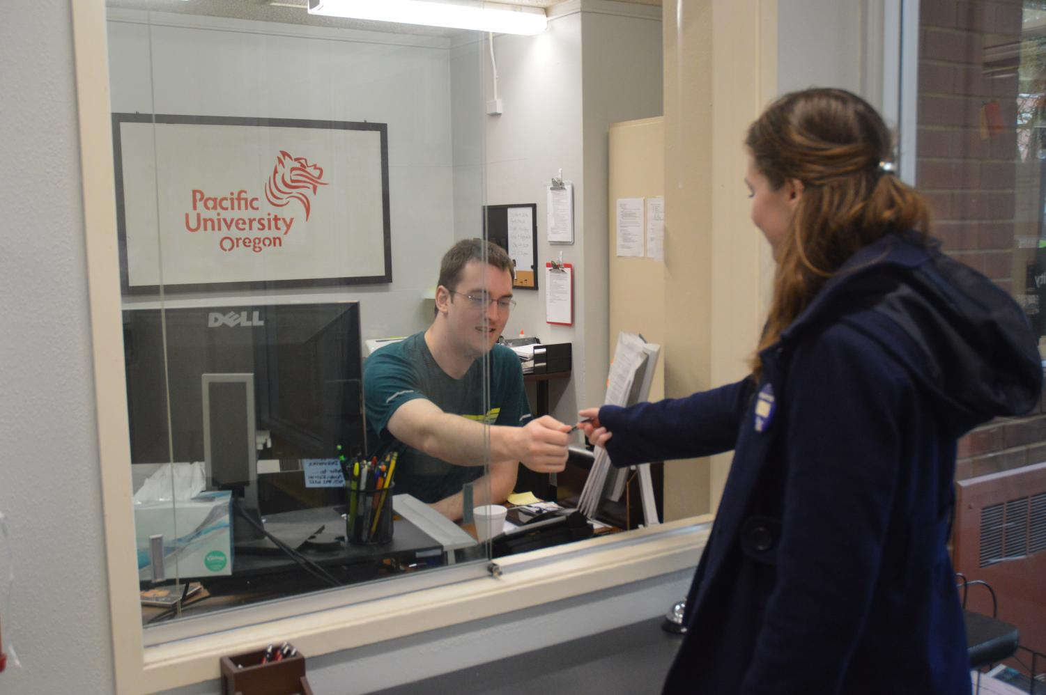 Student Jason Phennicie provides Boxers with discounted movie tickets to Regal Cinema at the front desk of Clark Hall.