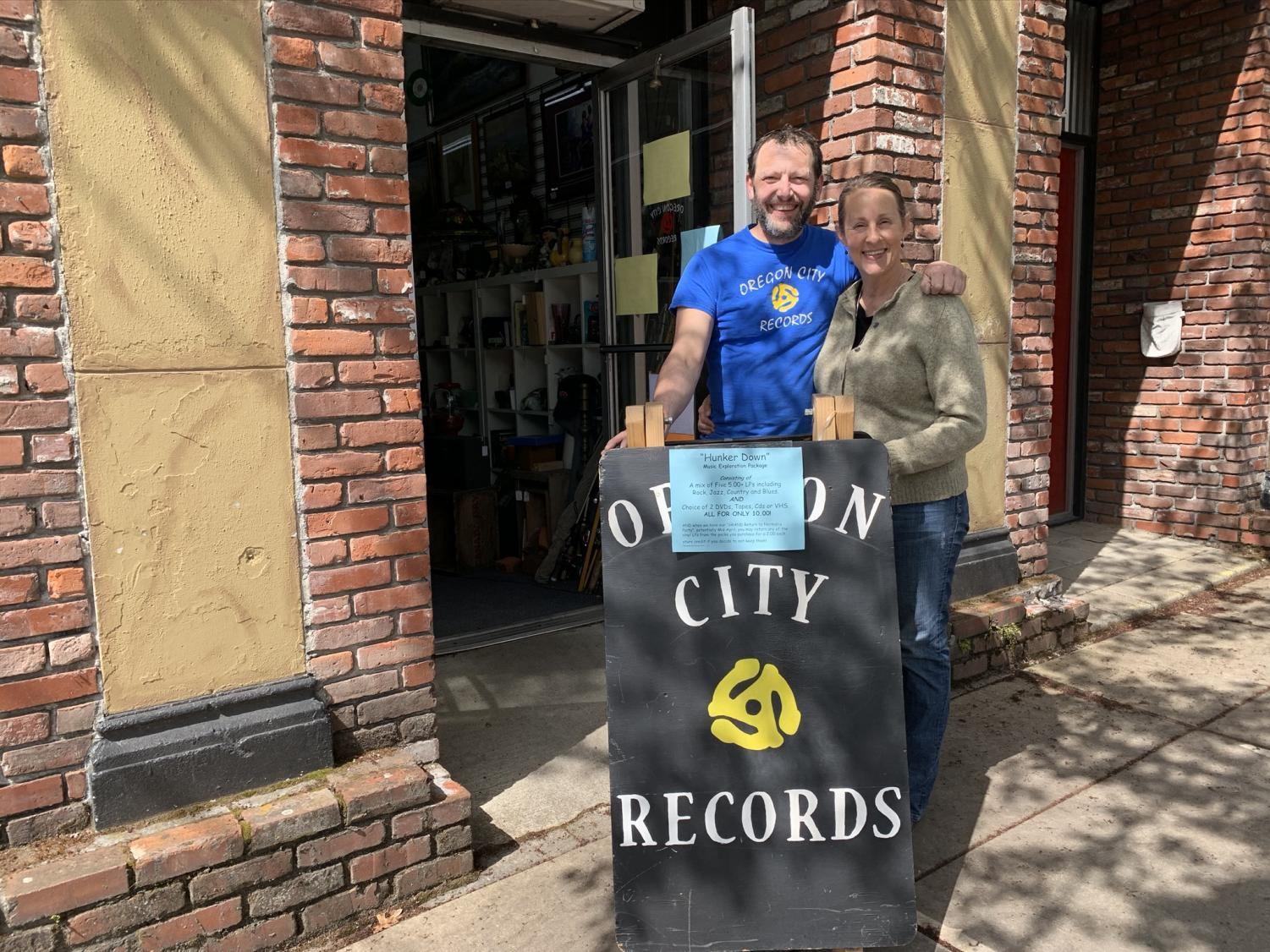Owners of Oregon City Records Tory and Jessica Economou stand in front of their business.