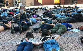 Protestors in Portland lie down for nine minutes June 2nd to protest the murder of George Floyd at the hands of police. Police officer Derek Chauvin knelt on Floyd's neck for nine minutes, causing his death. Protesters' faces have been blurred to protect their identities.