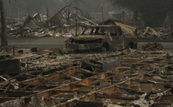 A torched car sits in the aftermath of the Alameda wildfire in Southern Oregon