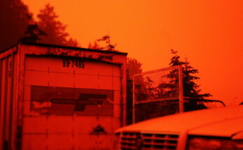Smoke and ash turns the afternoon sky in Salem, Ore. an unnatural red