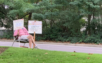 If you drive down Pacific Ave towards Hillsboro, you might catch Cindy Bronson sitting on a lawn chair in front of the Dollar Tree and Safeway holding up signs pointed towards traffic.