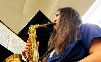 Student Allison Wills plays the saxophone during individual practice; an activity that has become common for music majors during COVID-19
