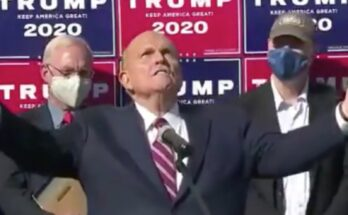 Screenshot of a C-Span broadcast of Rudy Giuliani's Four Seasons Total Landscaping press conference (from The Independent)